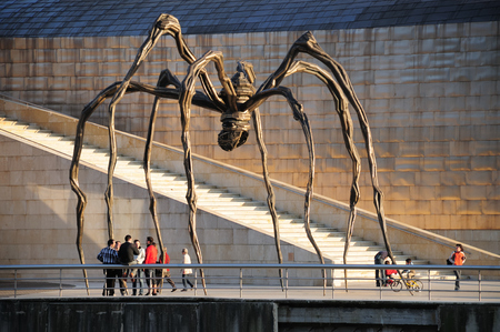Bilbao, Spain - May 02, 2009: The Spider, sculpture of Louise Bourgeois (1911, 2010) in the Guggenheim Museum Bilbao, Spain. Louise Bourgeois was an artist and sculptor. Her most famous works are possibly the spider structures, titled Maman, from the last Editorial