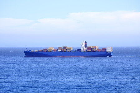 Blue container ship with a lot of containers