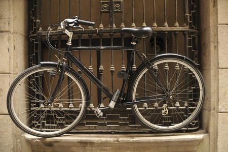 Bicycle chained to window bars in Barcelona, Spain