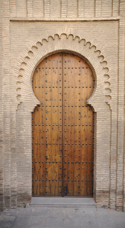 Medieval moorish-style door on a brick building in Toledo, Spain Фото со стока - 77746310