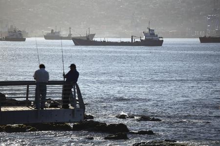 Fishing in Valparaiso, Chile. Фото со стока