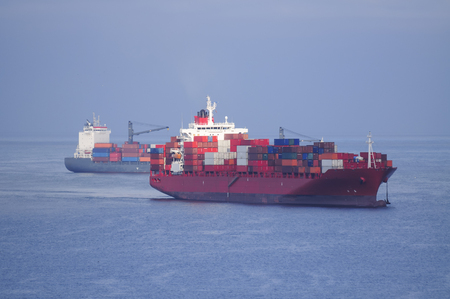 A Red Container Ship arriving at port, Valparaiso, Chile Фото со стока