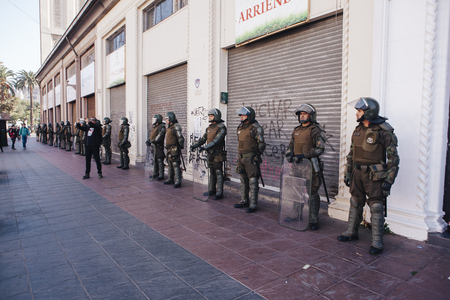 Valparaiso, Chile - June 01, 2017: Chilean riot police occupy the streets of Valparaiso, following President Michelle Bachelets annual state-of-the-union speech to Congress.