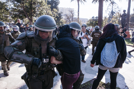Valparaiso, Chile - June 01, 2017: Protester arrested by the Chilean riot police during a protest in the center of Valparaiso, following President Michelle Bachelets annual state-of-the-union speech to Congress.