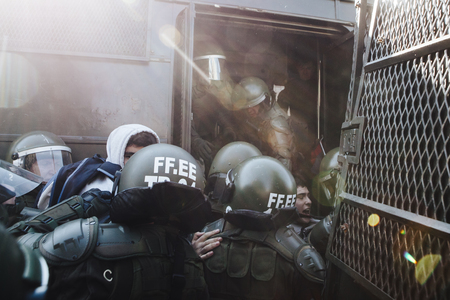 Valparaiso, Chile - June 01, 2017: Protester arrested by the Chilean riot police during a protest in the center of Valparaiso, following President Michelle Bacheletâ € ™ s annual state-of-the-union speech to Congress.