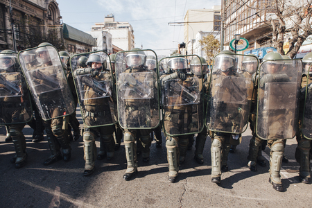 Valparaiso, Chile - June 01, 2017: Chilean riot police repress Protestants during a march on the streets of Valparaiso, following President Michelle Bachelets annual state-of-the-union speech to Congress.