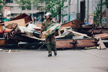 SANTIAGO, CHILE-NOVEMBER 8, 2019 - Riot police clear barricades in the church