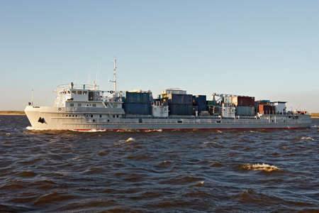 River vessel carries containers with cargo