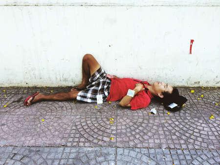poor man: Poor man sleeping on the street Editorial