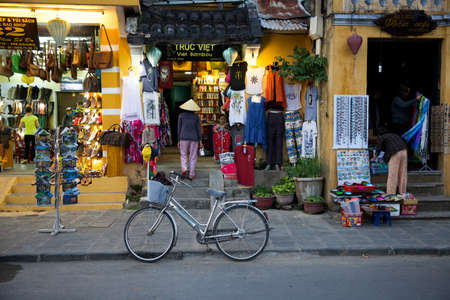 conical hat: Woman in traditional conical hat on the market street of Hoi An, Vietnam