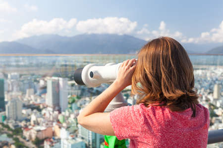 viewer: Young woman is looking through the tower viewer