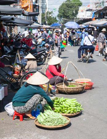 basket: NHA TRANG, VIETNAM - JANUARY 20: Women are selling greens at the market street on January 20, 2016 in Nha Trang, Vietnam.