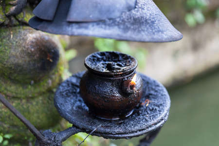 saraswati: Burning oil lamp in Pura Saraswati Temple. Ubud, Bali, Indonesia.