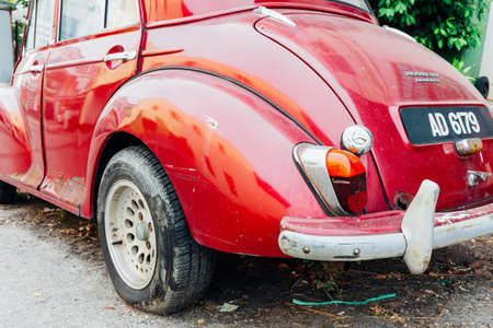 taillight: GEORGE TOWN, MALAYSIA - MARCH 24: Morris Minor 1000 parked on the street of George Town on March 24, 2016 in George Town, Malaysia.