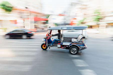 tuktuk: BANGKOK, THAILAND - APRIL 24: Man riding tuk-tuk on April 24, 2016 in Bangkok, Thailand.