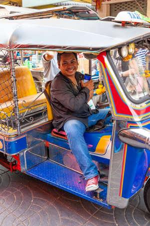 BANGKOK, THAILAND - APRIL 24: Tuk tuk driver wait for client on the street of Bangkok Chinatown on April 24, 2016 in Bangkok, Thailand. Editorial