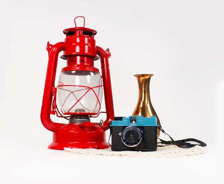 lomography: oil lamp - lomography camera - copper vase on lace