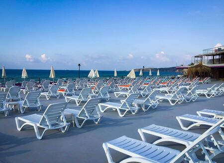 Umbrellas and sun beds at empty sandy beach of the Black Sea at Kilyos, Istanbul.