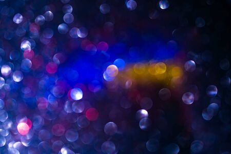 Holiday sparkles background. Abstract texture, light bokeh multicolour backdrop. Stock Photo