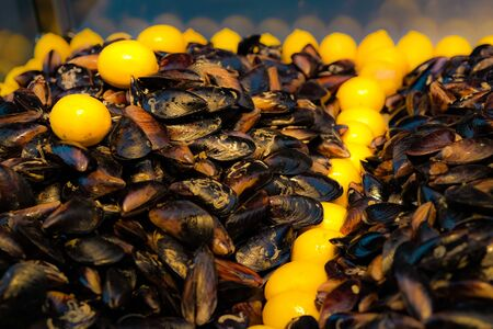 Ready to eat mussels stuffed with spicy cooked rice and lemon. Street fast food concept. Mediterranean region. Selective focuse.