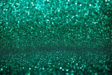 Abstract biscay turquoise green aquamarine defocused bokeh glitter sparkle confetti burst background. Festive concept.