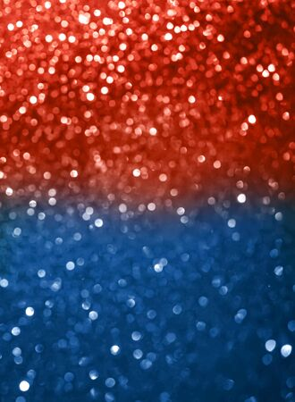 Abstract blue and coral red defocused bokeh glitter sparkle confetti burst background. Festive concept.Vertical format.