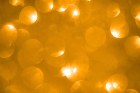 Abstract yellow saffron defocused bokeh glitter sparkle confetti burst background. Festive concept. New year, birthday, events and invitations. Vertical format. Stock Photo