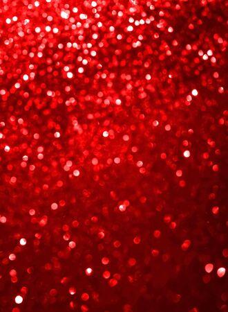 Resumen rojo coral defocused bokeh glitter sparkle confetti burst background. Concepto festivo Formato vertical.