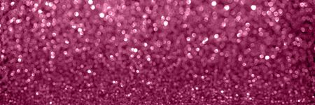 Abstract pink defocused bokeh magenta glitter sparkle confetti burst background. Festive spring concept. Web banner. Stock Photo