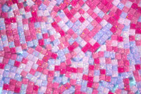 Abstract pink magenta and blue mosaic defocused bokeh glitter sparkle glass mosaic burst background. Festive spring concept. Stock Photo