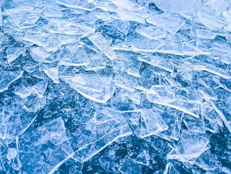 Crashed ice on the river or lake surface. Abstract background. End of winter, spring is coming concept. Stock Photo
