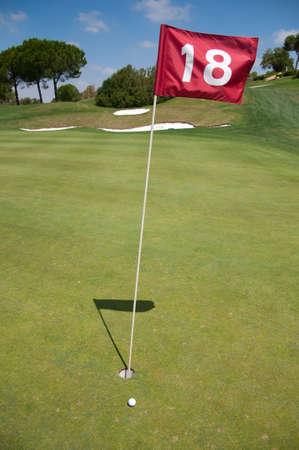 Eighteen hole of a golf course Stock Photo
