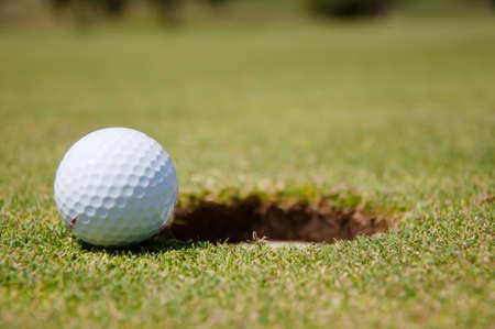 golf hole with ball
