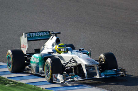JEREZ DE LA FRONTERA, SPAIN - 2012 FEB 09: Nico Rosberg of Mercedes-AMG team drives his F1 car during training session at Jerez circuit on February 09, 2012, in Jerez de la Frontera , Spain Stock Photo - 12257380