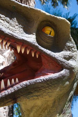 doll replica of a Tyrannosaurus rex