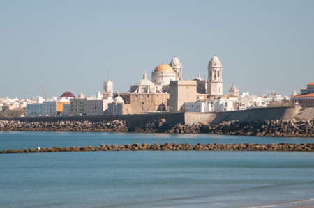 Landscape of the Cathedral of Cadiz from the beach photo
