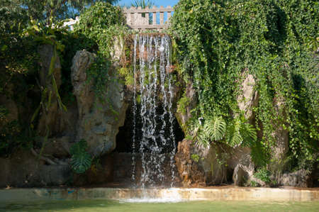 Waterfall and grotto in the Genovas park of Cadiz