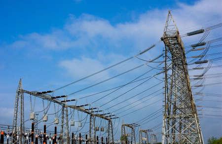 insulators: high voltage pylons, transformer and insulators, electrical distribution, overhead line Stock Photo