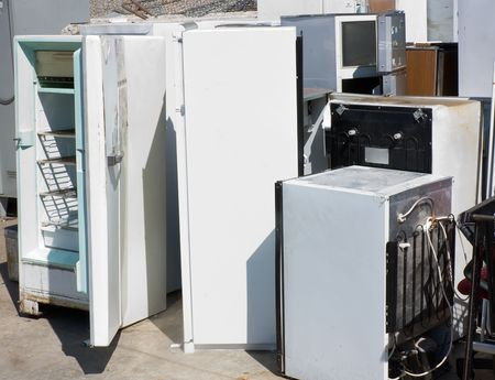 scrap heap: danger to the ozone, heap of old broken fridges containing cfc Stock Photo