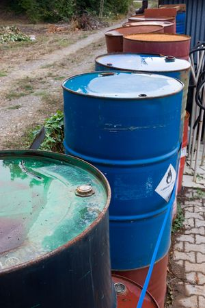 toxic waste, stacks of drum of chemical and inflammable substance photo