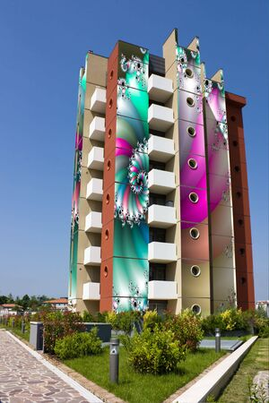 colored building, pictured with psychedelic drawings, photomontage with fractal images photo