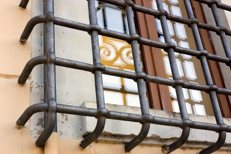 lattice window: window of antique palace protected with a strong iron bars