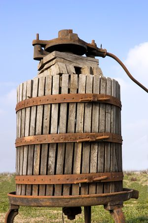 winepress: old italian wooden wine press for pressing grapes yo produce wine Stock Photo