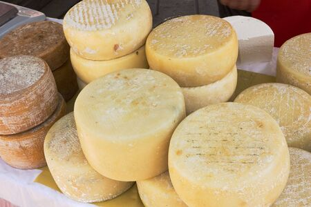 heap of italian ripe cheese - market of artisan products from south italy photo