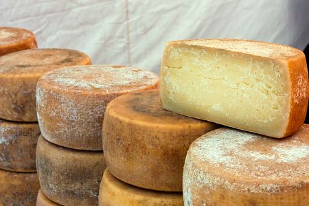 dry cow: heap of italian seasoned cheese - market of artisan products from south italy