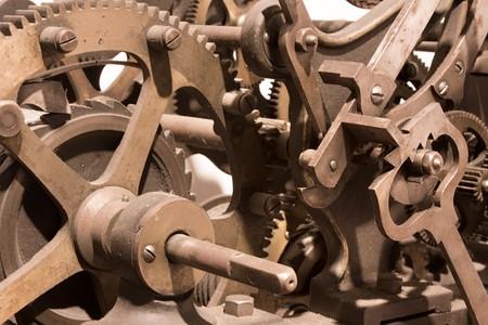 machine teeth: metal gears of an old mechanism - vintage clock tower mechanism - ancient clockwork machine