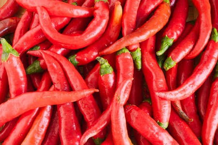 spicy chilli: market vegetable, heap of red and spicy italian chili, natural aphrodisiac
