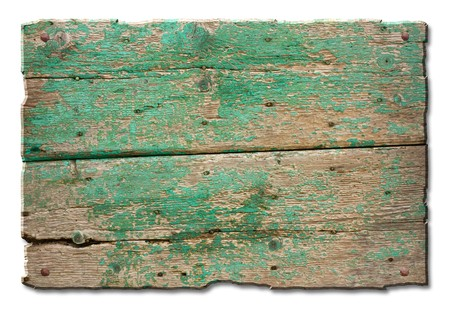 a blank tablet of wood with old nails and remains of green paint,  wooden banner for sign and inscription  Stock Photo
