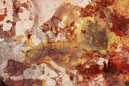 chipped plaster of dirty painted wall with drawn map of europe, decadent grunge abstract background