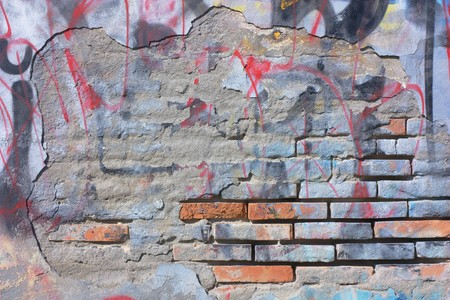 residue: chipped dirty wall with scratched graffiti and blank space for text